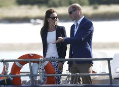 William gestures to his wife as they take the opportunity to catch up in the midst of a busy day of engagements