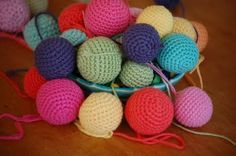 Crochet Ball Tutorial - so I can make some simple and colorful animal amigurumi for little ones by working up a smaller ball (head) onto a larger ball (limbless torso) and adding appropriate ears and tail.