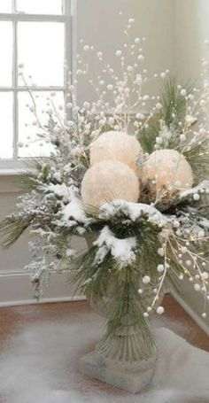 Take white balloons and white tissue paper. blow up balloons, dip tissue in glue, cover balloons and let dry. cut out a space for battery tea light and use in center pieces.
