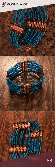 Blue and Gold Beaded Bracelet 12 stands of blue and copper beads with gold hardware Jewelry Bracelets
