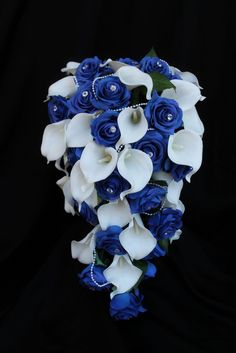 A stunning and dramatic wedding bouquet sure to put all eyes on the bride! Cascading bouquets are in this season and they are gorgeous! Our cascading rose and calla lily bouquet features over thirty o