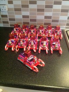 Santa sleighs for kids Christmas party. Made with candy canes, kit kat, poppets and fredo bars.