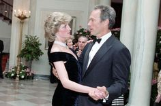 Princess Diana dances with Clint Eastwood. Wow I've never seen this one. Wonder what he is saying