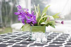 Modern Bat Mitzvah Centerpieces - Purple & Green Florals on Black & White Linens {5th Avenue Digital} - mazelmoments.com