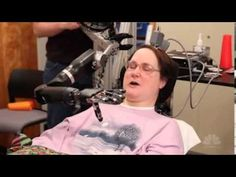 spinocerebellar degeneration -Woman Uses Her Thought to Control Robot to Feed Chocolate .