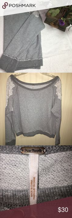 "Free People tattered lace sweatshirt Soft heather grey Free People pullover.  Beautiful tattered  lace shoulders and reverse colors seams.  Rubbed trim and bateau neckline.  Amazing condition!  For those days when you don't want to change out of your pajamas, throw this on over your pajama shirt and go pick up the kids!  No one will ever know!  Sleeves: 18"" bust, 20.5"" total length: 21"" (all measure approximate) Free People Tops Sweatshirts & Hoodies"