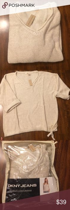NWT 😍 DKNY 😍 Sequin V-neck Sweater Very cute sparkly sweater! Never worn! Brand New with Tags! DKNY Sweaters V-Necks