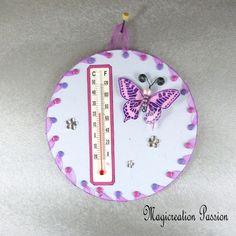 Thermomètre mauve papillon rose et violet sur cd - Un grand marché