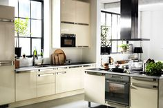FAKTUM kitchen with ABSTRAKT high-gloss yellow-white doors and drawer-fronts.