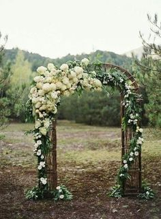 DIY outdoor wedding - love the way the flowers wrap and cascade down the arch.