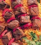 """This grilled fiery """"Spicy Werewolf Kabobs"""" goes great with fresh pitas, chopped onion, and sour cream to temper the black magic heat!"""