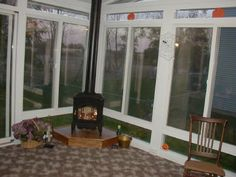 11 best sunroom with fireplace images fire places sunrooms fire pits. Black Bedroom Furniture Sets. Home Design Ideas