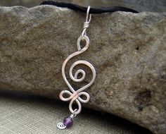 Celtic Budding Spiral Sterling Silver Pendant - With Dangling Amethyst. $16.50, via Etsy.