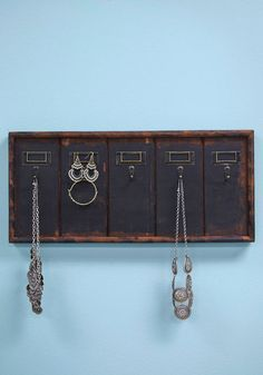 Archive Your Accessories Wall Hook. As a student of the library sciences, you bring your affection for organization into your home with this wooden wall decor! #gold #prom #modcloth