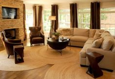 I like the effect of the overlapping circular rugs that almost look like tree rings.