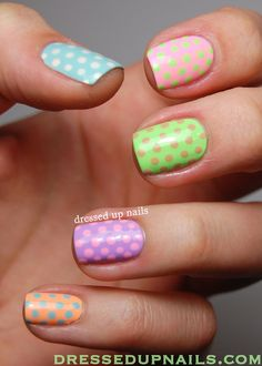 dressedupnails: I'm finally back with a (very belated) post about my Easter nails! These were easy and fast and I don't think you can ever really go wrong with polka dot skittles. Check out the full post for more!