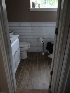 wood tile floor in the bathroom | Tile floor that looks like wood, totally awesome! | Bathroom Ideas