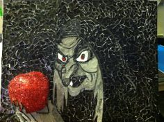 This piece is called the Evil Queen. She is of collage style as well as sculpture. The apple is 2-D as well as collage. It is 24x18 in size.