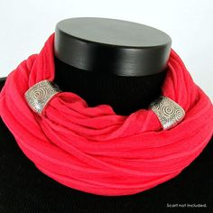 These scarf jewelry slide pairs are silver tone inset with black etched designs. These are fun on their own or can be coordinated with other scarf jewelry pieces. They come in three very different styles to fit your fashion taste. Scarf not included.