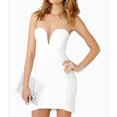 Nasty Gal Helix dress Never worn. Sold out online!! *white hot body-con dress featuring a plunging sweetheart neckline with boning and a curved hem. Zip closure at back, stretch fabric. Hand wash cold. Nasty Gal Dresses Mini