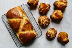 How to Make Brioche at Home Makes 2 loaves or 16 individual brioches  4 teaspoons active dry yeast 1/3 cup water, at 110º F 1/3 cup milk, at 110° F 2 tablespoons sour cream or yogurt 4 cups all-purpose flour 2 teaspoons salt 3 tablespoons sugar 4 large eggs 3 sticks (12 ounces) unsalted butter, cool but pliable 2 tablespoons pearl sugar (optional)