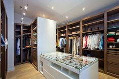 This large walk-in closet has plenty of space for all of your clothes, as well as an island just for accessories.