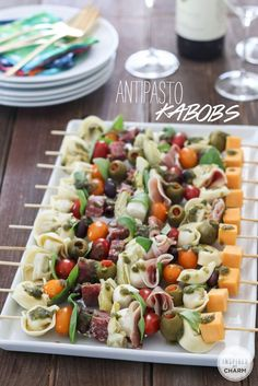 Antipasto Kabobs cherry tomatoes tortellini, cooked and cooled olives, kalamata and green salami, cubed prosciutto, sliced sharp cheddar cheese, cubed basil leaves basil pesto wood skewers  Skewer the above ingredients onto wood skewers; then drizzle with basil pesto.