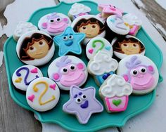 Dora and Boots Cookies~                    No source, pink, blue, cupcake, number