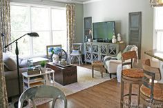 shutters on either side of tv, mirrored console, bar stools look like ballard