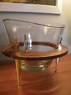 Mid Century Ice Bucket Bowl  The big glass bowl sits in a teak and brass stand. I'd probably use it for potato chips!
