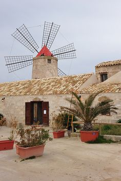 Windmill, Riserva Naturale Integrale Saline di Trapani e Paceco, (nature reserve) Sicily.  Photo: tango- via Flickr