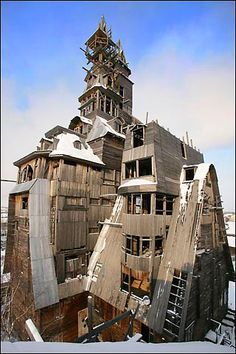 Located in Arkhangelsk, Russia, it is believed to be the world's tallest wooden house, soaring 13 floors to reach 144ft – about half the size of the tower of Big Ben…. and built by a ganster.
