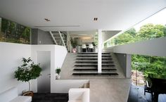 Stairs, stairs, and more stairs. Oh, and windows. Any house with a grand piano is okay by me - Sharp House by Esprex