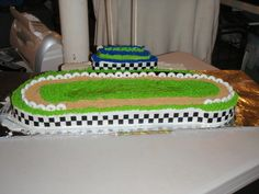 this is the cake minus the donuts, make the dirt track asphalt, add people on bleachers with safety cages per cor Race Track Cake, Race Car Cakes, Dirt Track Racing, Birthday Cakes, Boy Birthday, Birthday Ideas, Birthday Parties, Racing Cake, Cupcake Cakes