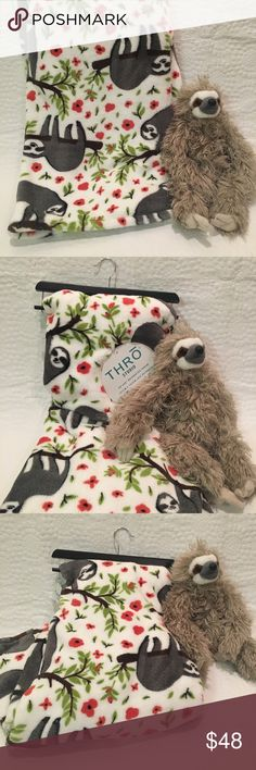 "Super Soft Sloth Plush Throw Blanket NWT Every sloth lover needs this adorable and oh-so-soft plush throw for their home! White throw features hanging sloth print with red flowers. Measures 50"" x 60"". 100% polyester. Machine wash. NWT and comes with wooden hanger for easy storage. So unique and fun—great for bedrooms, living rooms and kids! 🚫trades. Bundle & save!! *Plush sloth NOT included—that's my baby! Other"