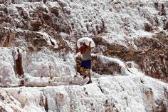 A worker carries a bag of salt through pools of salt at the Maras mines in Cuzco, Peru on August 29, 2012. The Maras mines have been a source of salt since ancient pre-Incan civilizations and now comprise about 3,000 small pools constructed on the slope of a mountain in the Urubamba valley in the Andean region of Cuzco. (Janine Costa/Reuters)