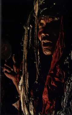 "A Tibetan nomad shaman of Nepal's remote Dolpo district invokes a mountain god called ""Fierce Red Spirit"" to help him heal a patient. He is part of an ancient Tibetan way of life that combines anamism with the teachings of Buddha. ~ National Geographic April 1977"