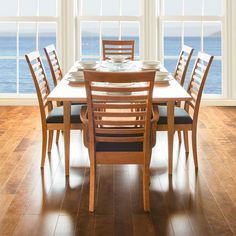 Our elegant, American-made Ladder Back Dining Chairs will bring an air of sophistication to your dining room. Made to order in Vermont, of natural solid wood, they are extremely comfortable and durable too!