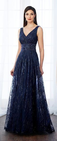 Sleeveless sequin and tulle A-line gown with front and back V-necklines, hand-beaded wide natural waistband, sweep train. Matching shawl included.