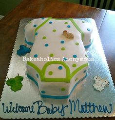 Baby Onesie Cake...I don't really care for the naked small baby on the cake, but the idea is cute                                                                                                                                                                                 More
