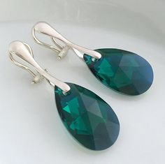 This beautiful pair of earrings is made with high quality hallmarked 925 Sterling Silver Clip ons. I used crystals from Swarovski Crystallized Elements collection in Pear shape. Colour - Emerald AB Green Size of crystal - 22 mm  (also available in other colors)  Total length of earrings - 4 cm  ONE OF THE BEST GIFTS FOR HER FOR EVERY OCCASION:  This item can be a perfect gift for Valentines Day, Mothers Day, Birthday, Christmas, also fabulous Bridesmaids or Anniversary gift for her.  All my…