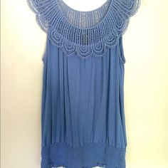 Top Medium blue pull over top with 4 inch panel gathering at bottom.  Crochet type lace embellishes the neck area over the shoulders and scoops slightly in the back. Cable & Gauge Tops Tunics