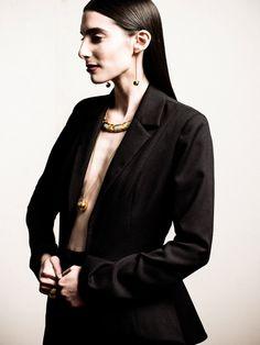 Danielle Kosann wearing Nonoo suit and Camilla Dietz Bergeron + Monica Rich Kosann jewelry