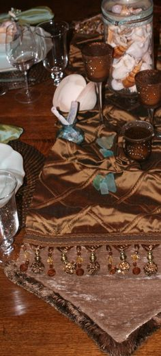 Our grey and tan leopard chenille and silk Luxury Table Runner embellished with Coco beading and over-sized jeweled brads creates an elegant look to compliment any Home Decor. By Reilly-Chance Collection