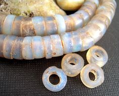 Antique European, Opalescent Glass Bead Slices, 10mm 6.14  I absolutely LOVE this bead - made in the 1800s, their patina is worn and smooth and
