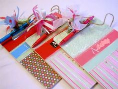 Mini personalized clipboards for kids. Scrapbook paper, mod podge and ribbon is all you need!