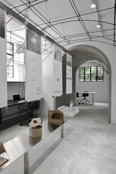 New Shanghai Office Pays Tribute to its Historic Location The main office area and the exhibition table. Photo by Song Xiaodan.The main office area and the exhibition table. Photo by Song Xiaodan. Shanghai, Grey Interior Doors, Exhibition Room, Workplace Design, Architecture Office, Architecture Models, Co Working, Retail Shop, Ceiling Design