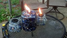 """Diy tiki torch i came up with ..... get a Glass jar with metal lid, drill a hole through the lid and put the tip of a wick through, fill with citronella oil, place the jar in another (larger) glass jar (prefferably one with a lid so you can store it outside) and fill with glass beads/ stones. You can put a oil level """"peak hole"""" by placing a small chunk of pvc pipe or a mason jar ring in the larger jar before filling it with beads"""