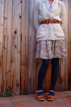 Everyting I love about! Sweater, floral skirt, tights and clogs!!