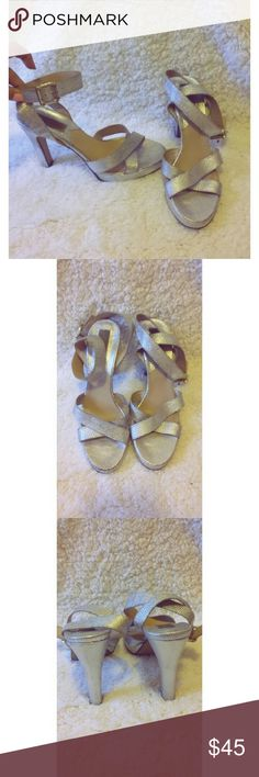Michael kors silver ankle strap heels size 7 Women's Michael kors Silver ankle strap heels Size 7  These are worn in. But anyone who owns a pair of Michael kors shoes knows that they last forever.  There are some minor scuffs here and there. A stunning heel.  My fiancee bought these for me online but didn't pay attention to size, he clearly forgot I have Amazon feet. Lol MICHAEL Michael Kors Shoes Heels